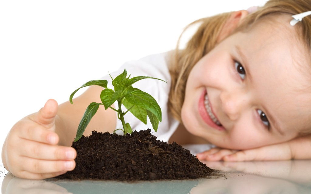 wallpaper_of_baby__a_lovely_girl_and_a_small_plant